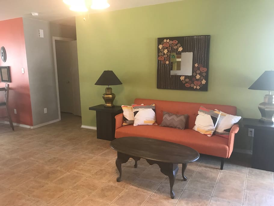 Living room- has one sleeper sofa, two lounge chairs, and TV. There is plenty of room for an air mattress.