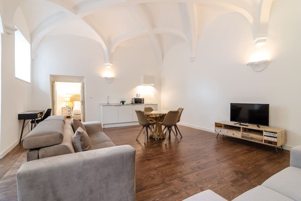 15th Century vaulted ceilings in living room with kitchenette