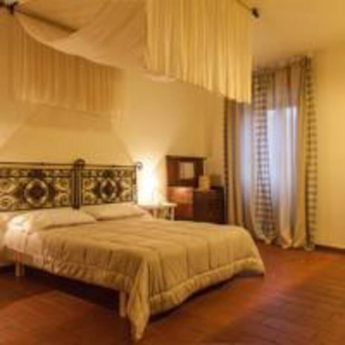 camera da letto appartamento Echinacea