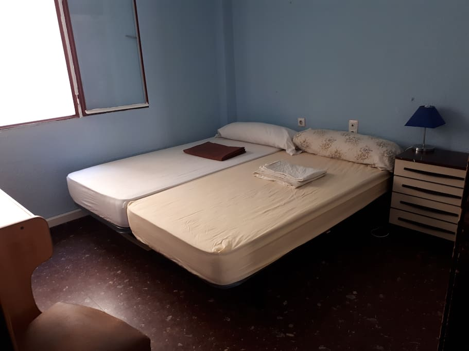 Room with 2 normal-sized beds