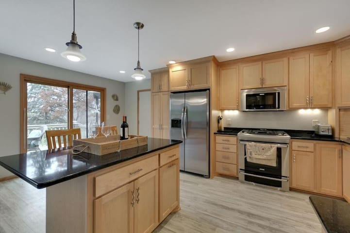 Large entertaining kitchen with island to entertain.