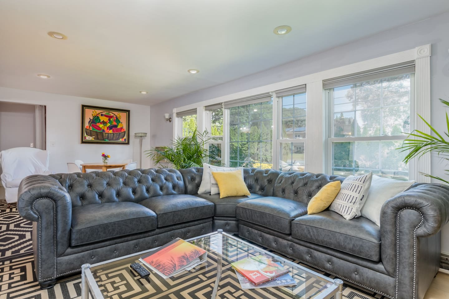 Large, airy, comy living room with lots of natural light.    Huge sofa seats all your friends while watching a great Netflix movie or playing one of the many board games available,