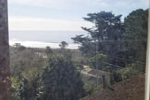 View to Ocean from Master Bedroom Window on fireplace wall.