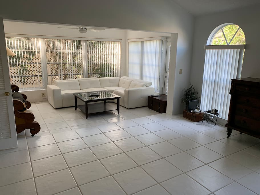 Spacious and bright living room with new white leather couch