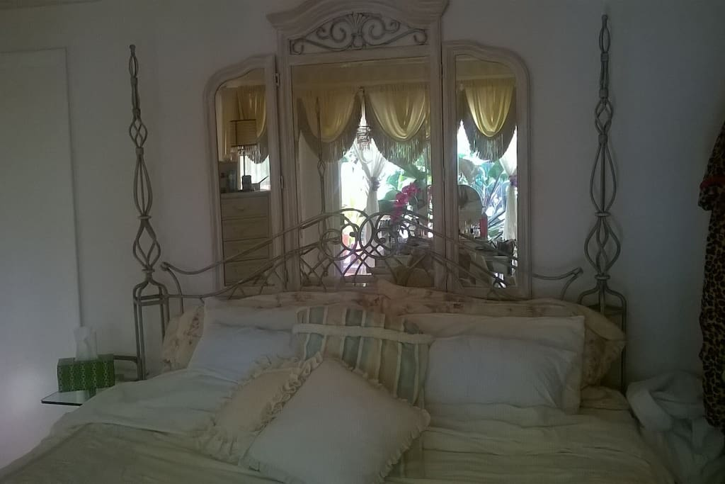 Master bedroom with view of Pergola and Waterway, King bed, luxury pillow top mattress