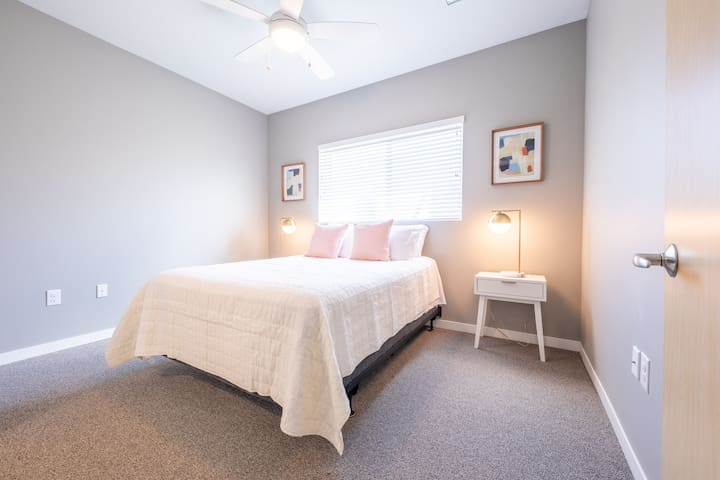 The master bedroom has a queen bed, walk-in closet, and attached bathroom.