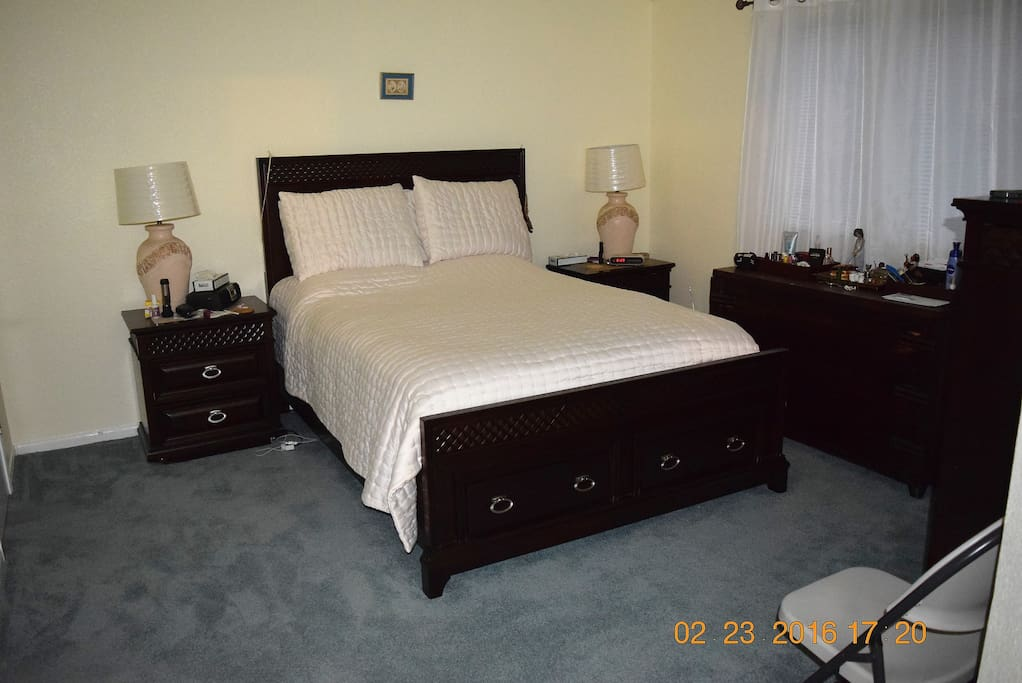 Master bedroom with Queen size bed, walk-in closet and master bathroom