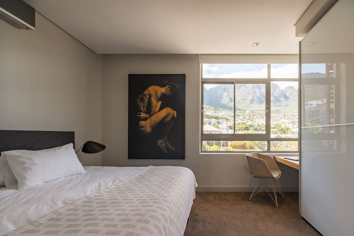 Bedroom 2 with mountain views (2 singles as king)