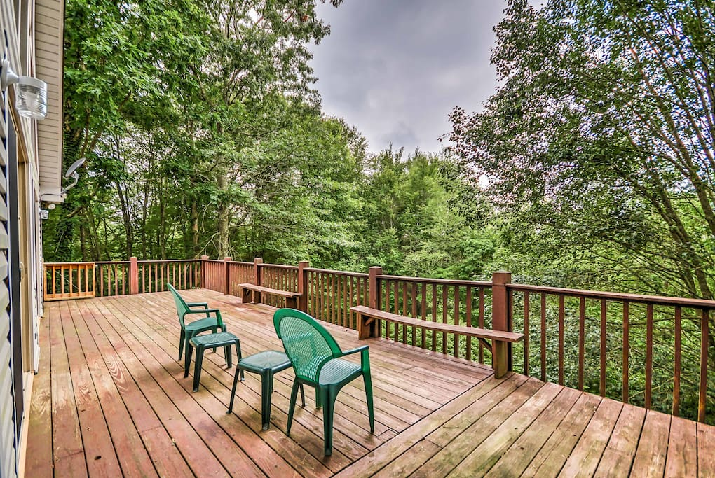 Enjoy pleasant afternoons on the back deck, which looks out upon the dense forest.