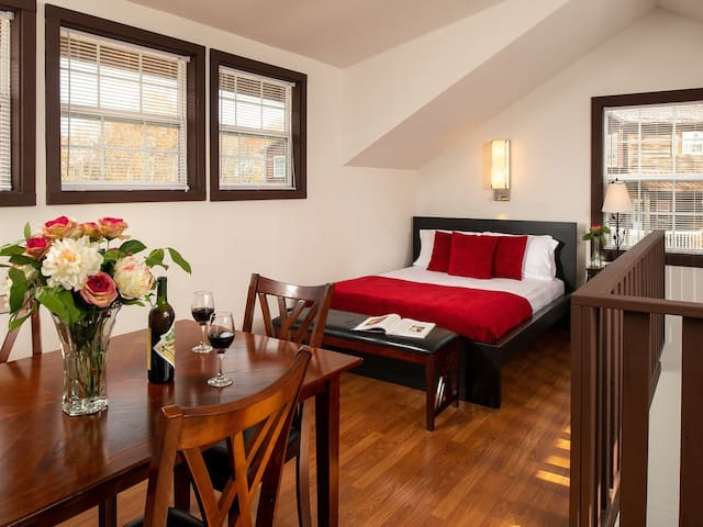 Dining room loft with a queen size bed and half bath that overlooks the living room