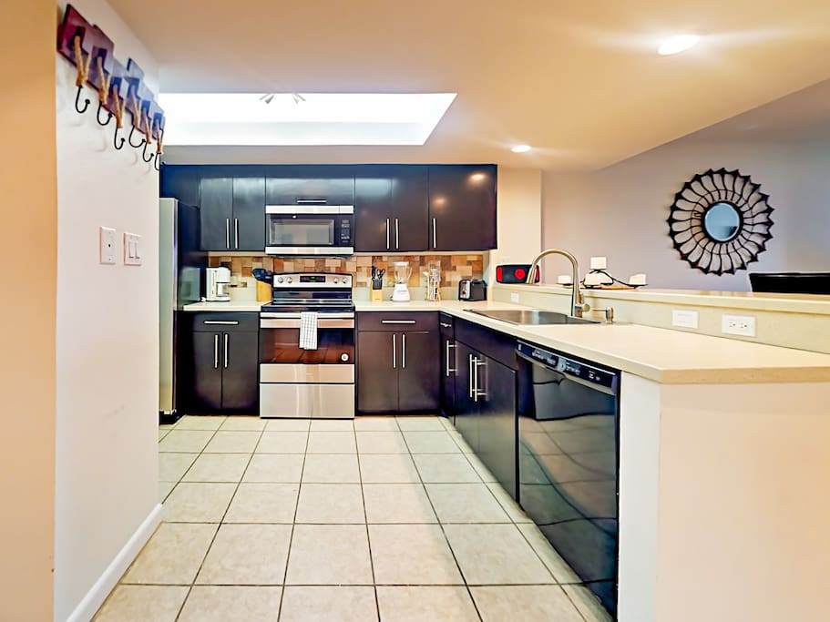 Large open kitchen offers ample prep space for the chef. Starter supply of kitchen amenities (dish soap, paper towels) included.