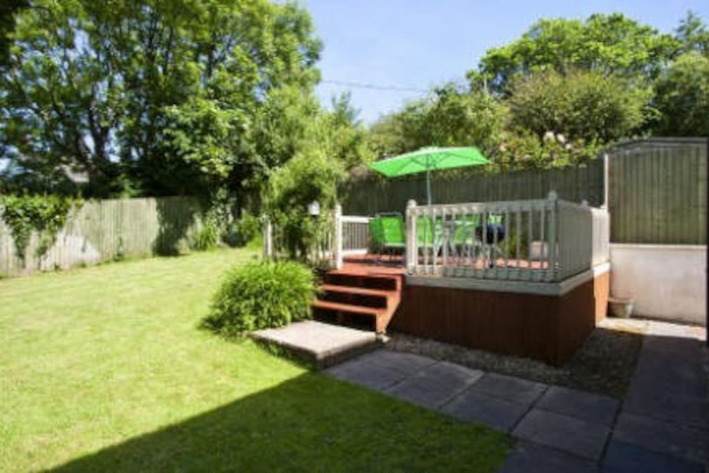 Sheltered and private garden with large decked area and patio furniture