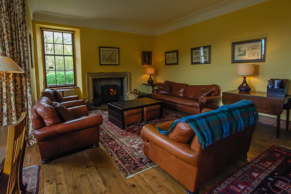 The comfortable sitting room with wood burning stove.