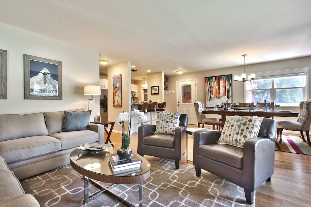 Cozy living room with sectional couch, club chairs, gas fireplace, and HDTV