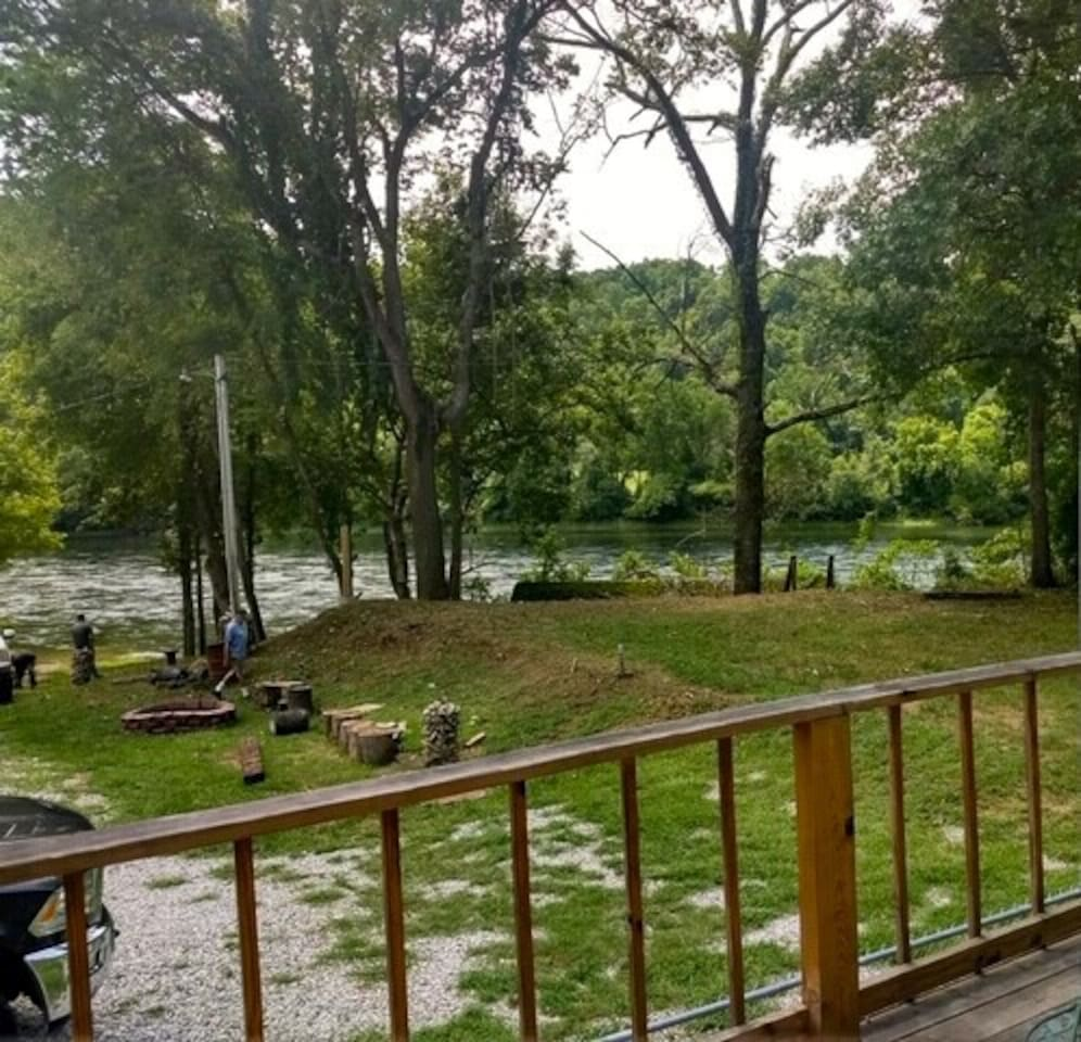 Your white river view from your private deck with pictured fire pit