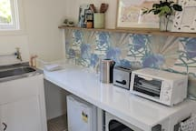 Kitchenette with Toaster, Kettle, Grill, Microwave and Bar Fridge.