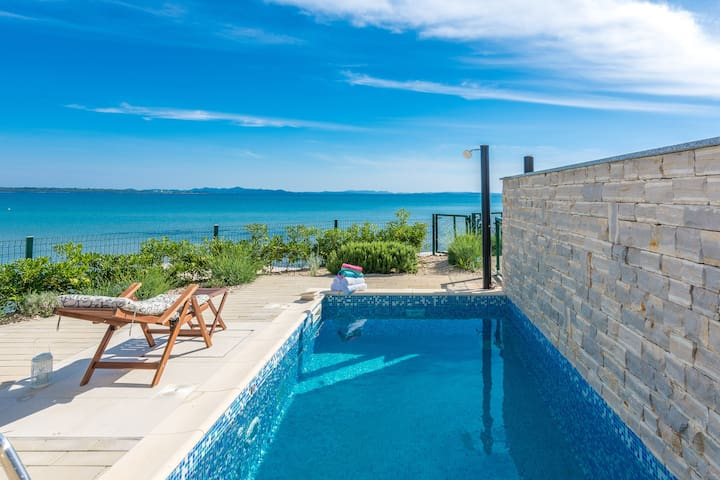Private villa with heated pool on sandy beach