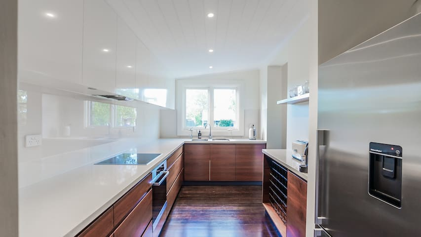 The Kitchen is equipped with a Miele oven and induction cooktop, a dishwasher, beautiful Spode Italian Blue China and quality French made Mauviel cookware sourced from Trentham's Philip & Lea (now also in Gertrude Street, Fitzroy).