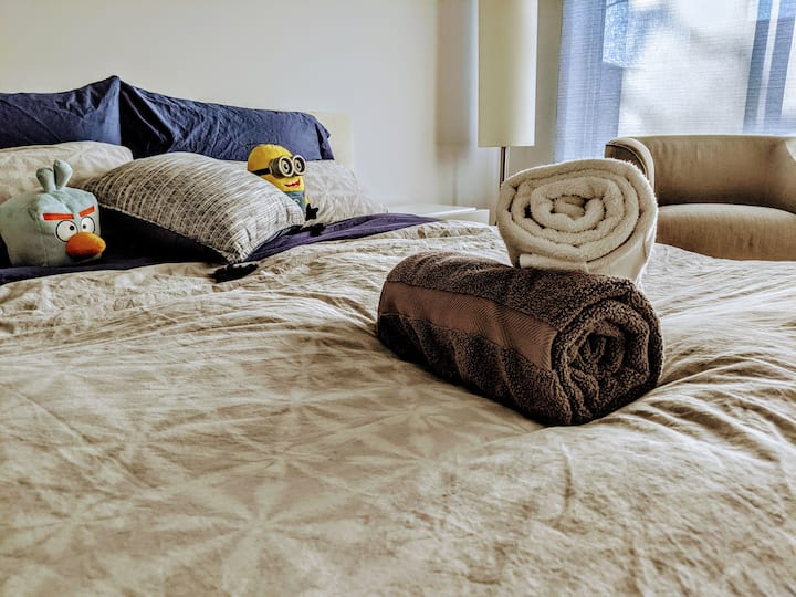 Luxurious king bed with space to work