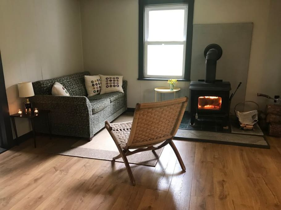 Living room with an easy to use wood burning stove - we supply firewood!