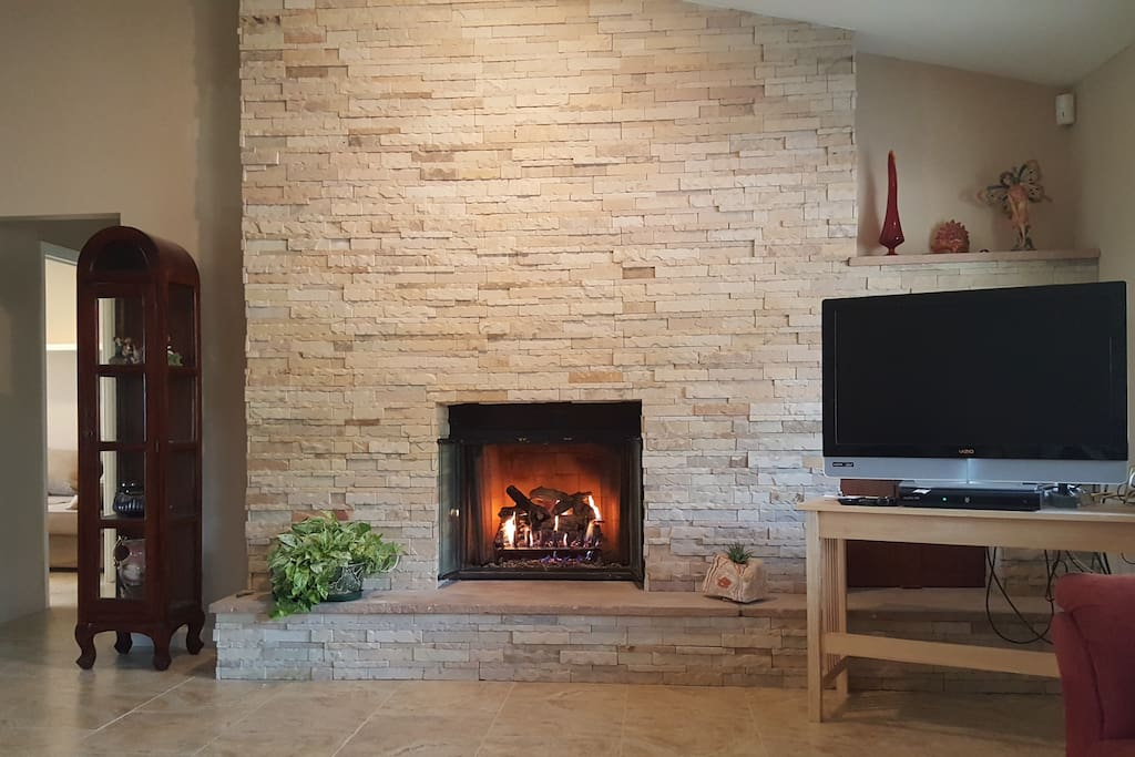 Warm and cozy gas fireplace in living room.