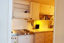 Small kitchen with stove and microwave oven