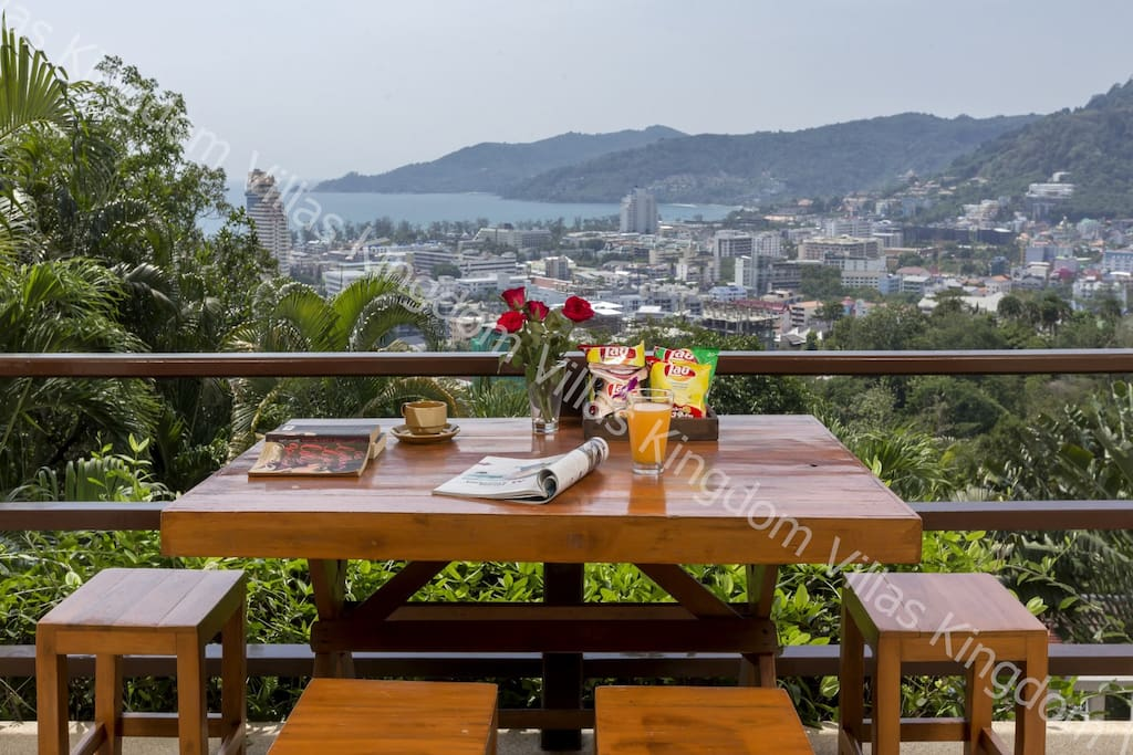 outdoor dining on the upper terrace with sea views and overlooking the private swimming pool