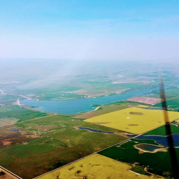 Aerial view - yellow canola fields visible