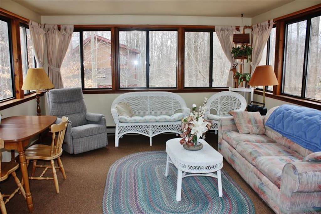 The bright sunroom offers wooded views & glimpses of wildlife!