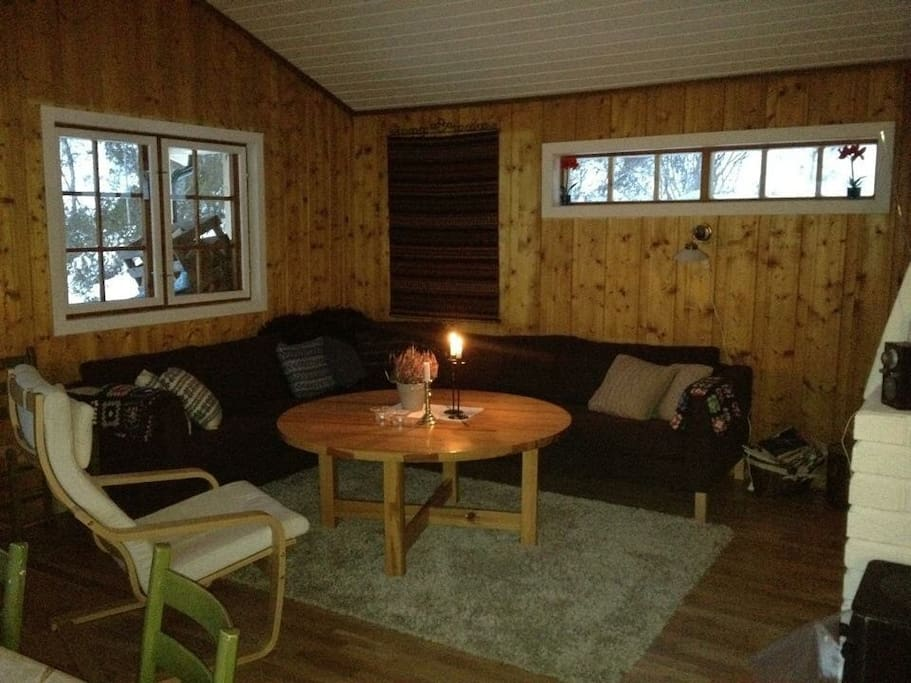 Cosy living room with woodstove and open fireplase