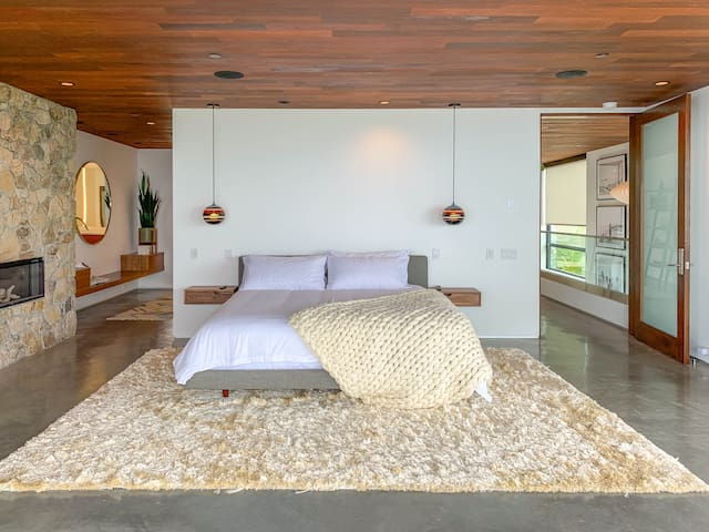 Master bedroom with sitting area, fireplace, huge views, and en-suite master bathroom