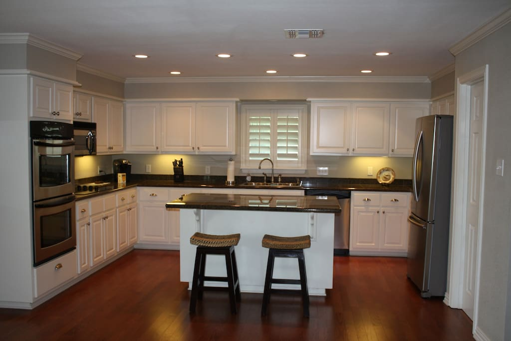 Kitchen with granite and stainless steel appliances.