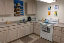 Full kitchen includes refrigerator, stove/oven, microwave, and basic dishware. Guests are also provided complimentary coffee and tea!