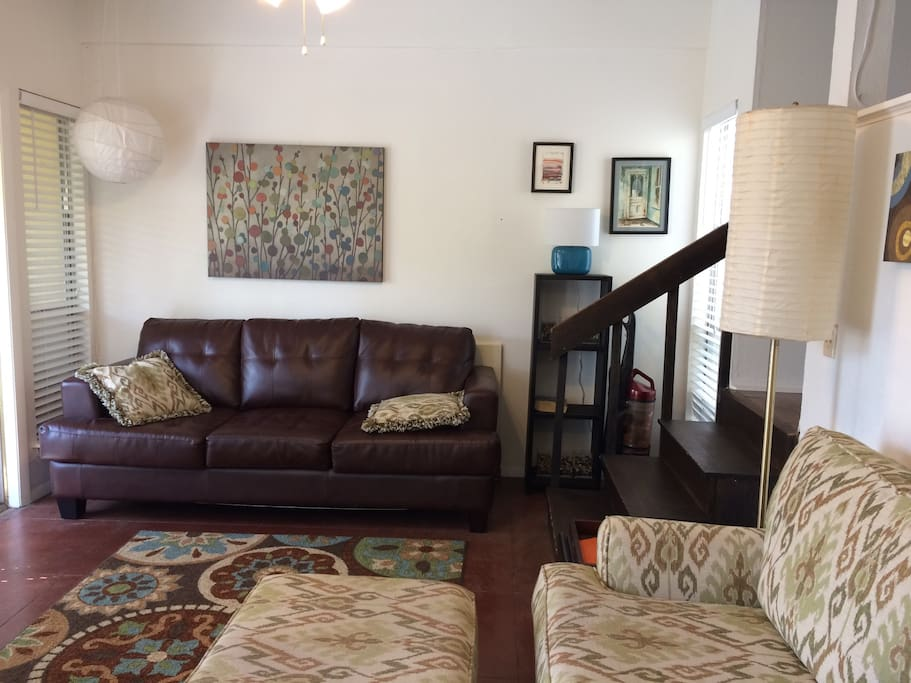 Living area, sofa bed.  Stairs lead to bedroom area