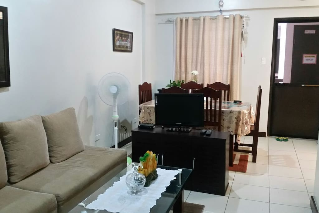 living room and dining room. TV with digital box channels.