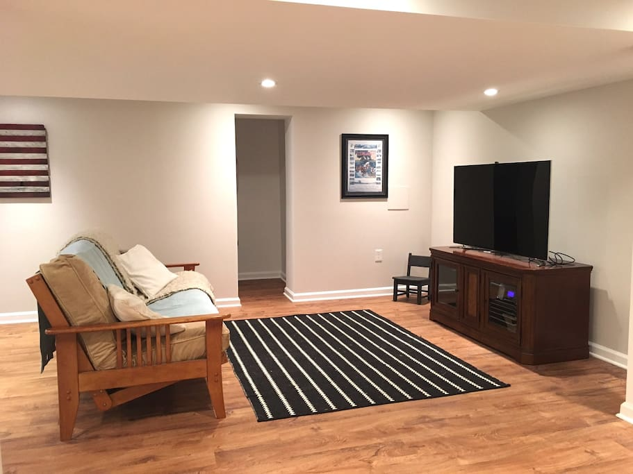 large living room with tv with DVD player, movies, radio and wifi in unit. No cable.