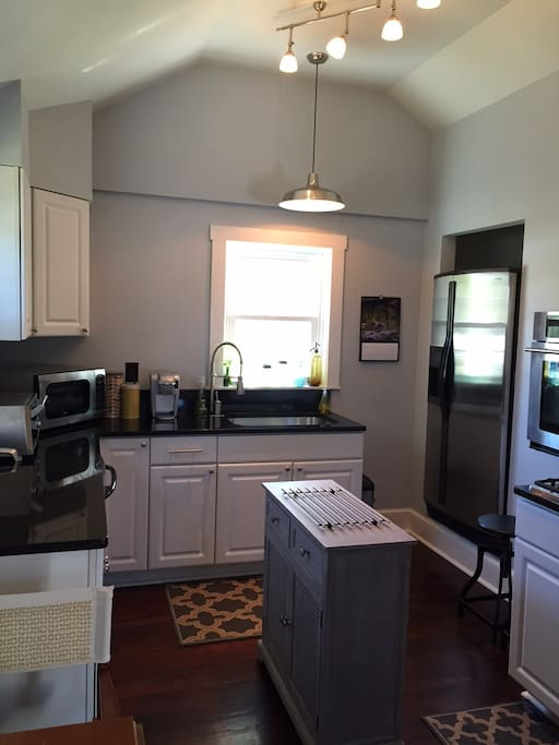 Modern kitchen includes microwave, dishwasher, toaster oven, ice maker/filtered water, tea kettle and Keurig