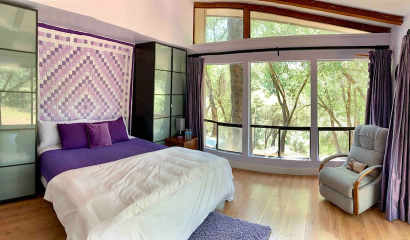 Primary Suite feels like a Treehouse with of nature enveloping the view.