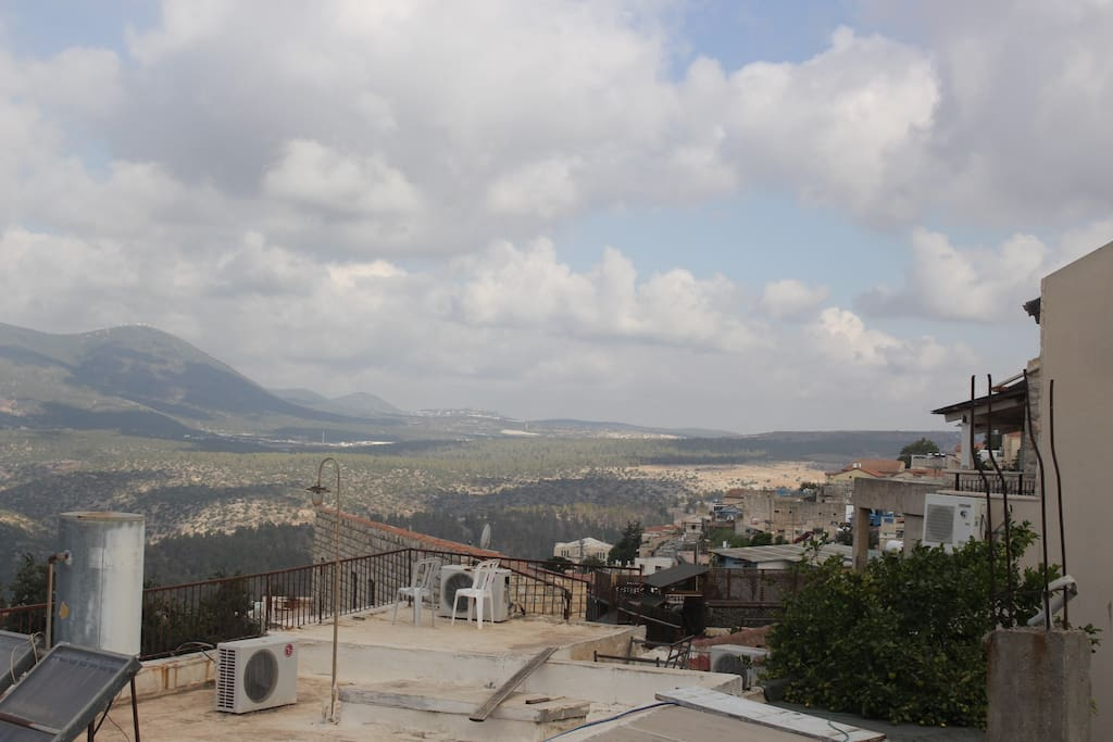 What other people have to see from climbing to their rooftops, you can see from the comfort of INN Tzfat's living room!
