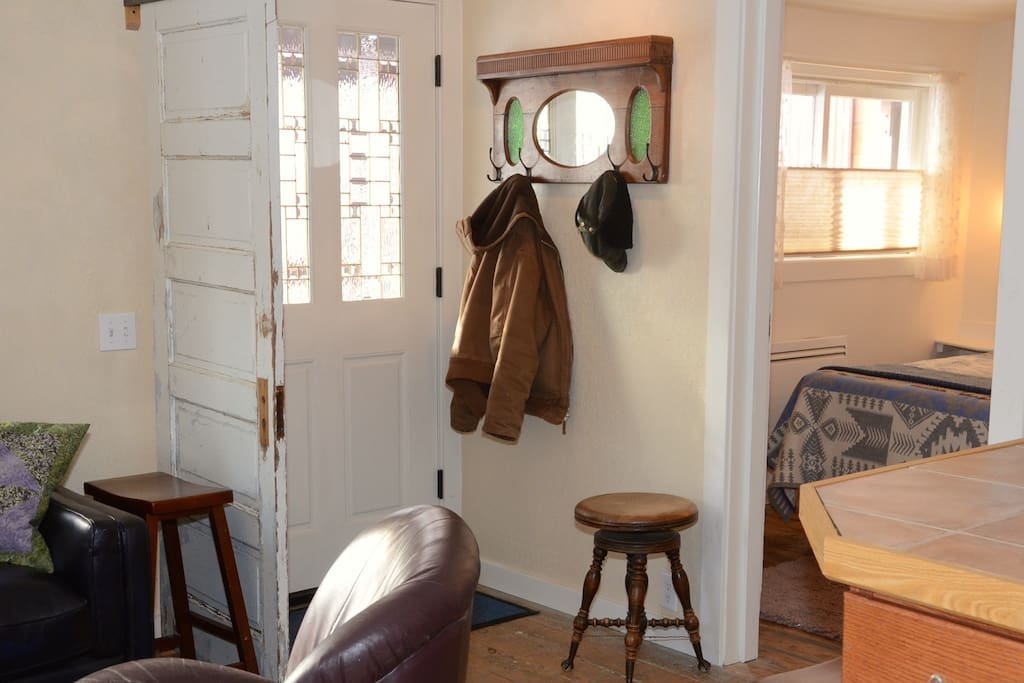 Hang up your coat and stay awhile in this restored 100 yr old building!