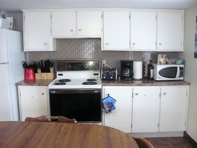 Fully equipped kitchen and shared dining room