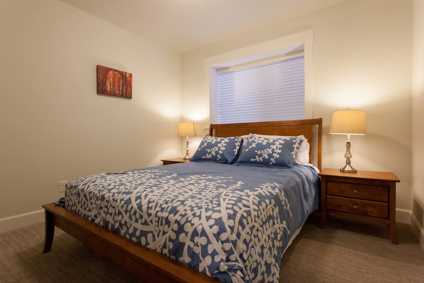 Bedroom with queen sized bed, soft microfiber sheets, plush pillows, large closet, 2 night stands