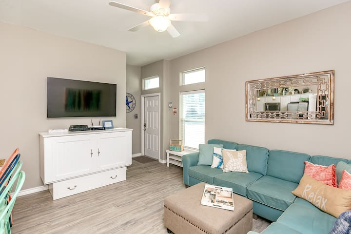 Comfortable seating for 7 in the living room, as well as a pull-out queen-size bed from the entertainment center.