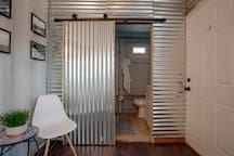 The sleek sliding bathroom door inside the guest shipping container.