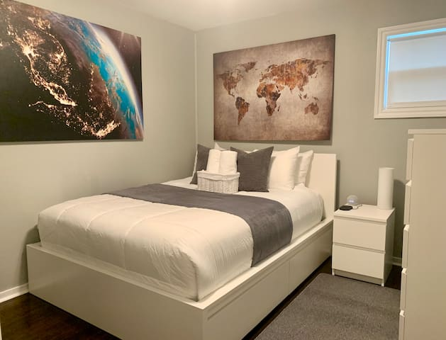 Suite 2 is a smart room that has a modern queen size bed with premium linens, medium to firm pillows for different style sleepers, 2 premium robes in the closet, true HEPA Air Purifier, voice controlled climate,  lighting, music and more.