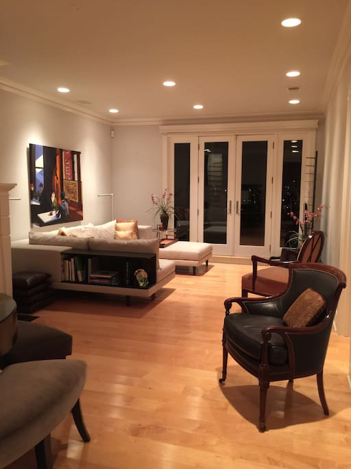 Main living/dining area - French doors open to massive City- view deck!