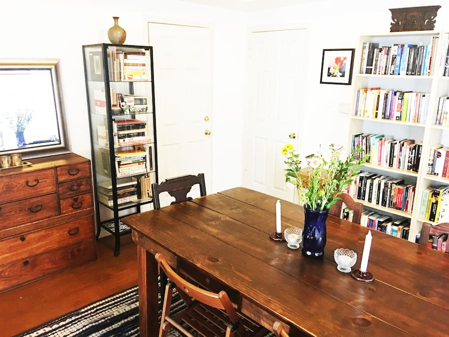 Large Dinning Room  includes a side Patio.  Solid wood table and midcentury hutch table.