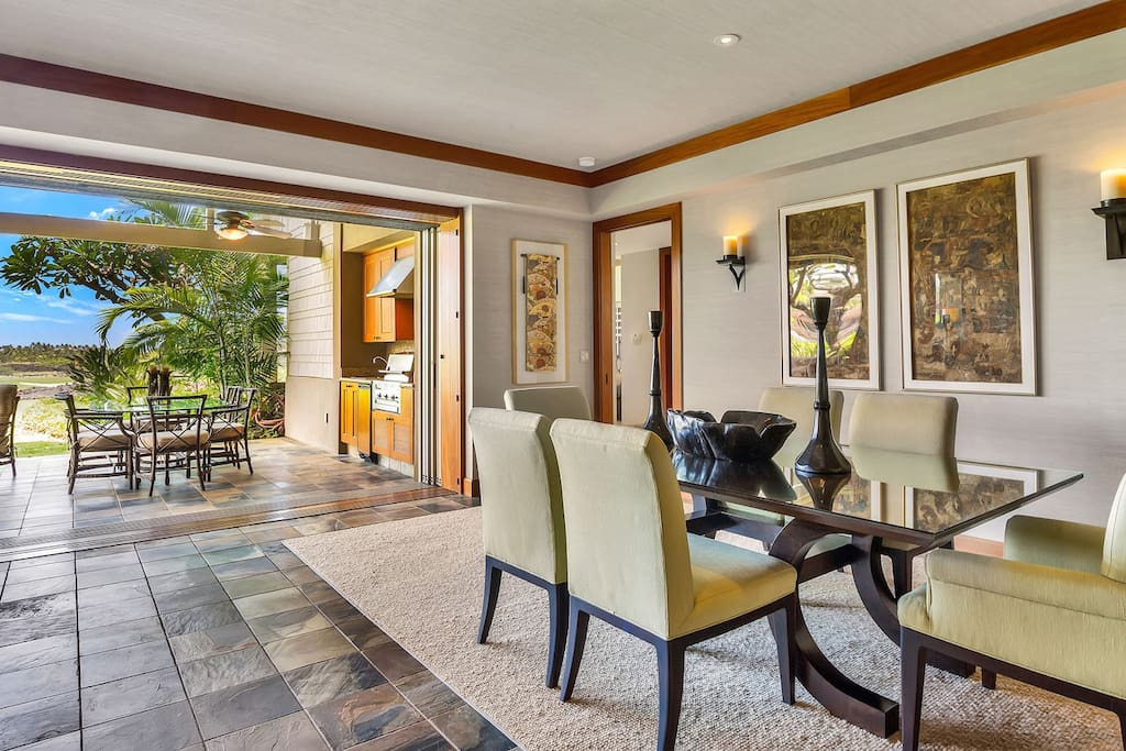Elegant dining area, floor to ceiling pocket doors open out to the lanai