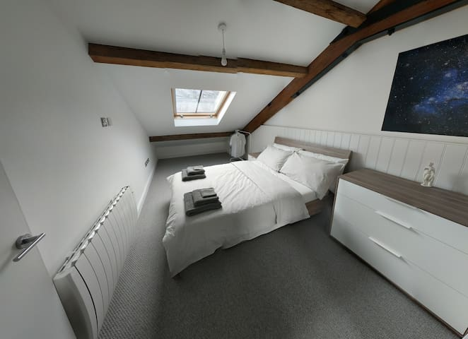 Hunker down in this cosy loft with original wooden beams. Drawers and hanger provide plenty of space to unpack, and a full-length mirror is at your disposal. The inclined headboard is great for reading and the blackout blind does wonders for a lie in