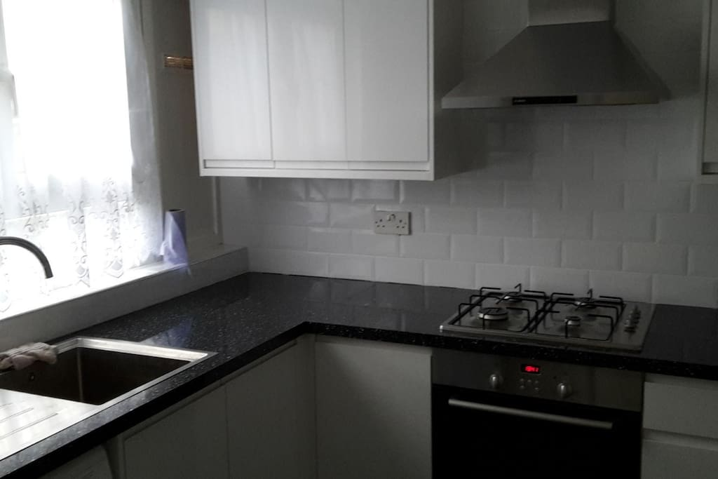 Brand new fitted kitchen with all required facilities especially the washing machine for those staying longer!